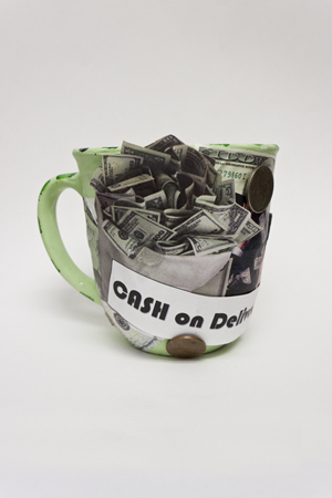 cash_on_delivery_KCRG_Mug_300pix.jpg